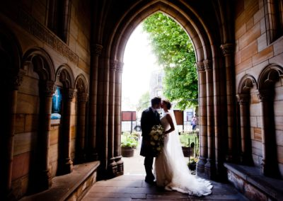 a couple in their wedding photograph at holy trinity church st andrews