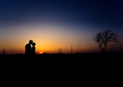 a couple photographed against a sunset at airth castle