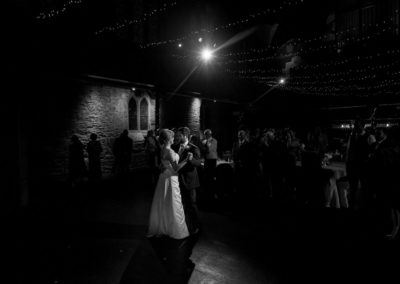 a couple share their first dance at their cottiers theatre wedding