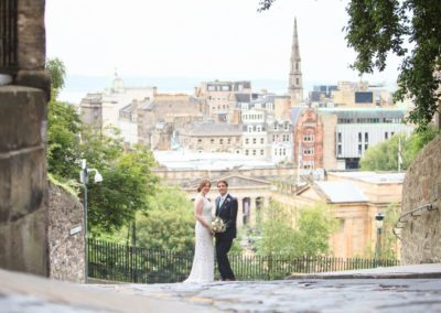 a couple overlook edinburgh in their wedding image