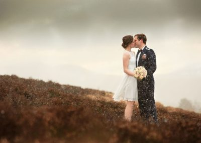 a couple share a kiss on their elopement in aberdeesnshire