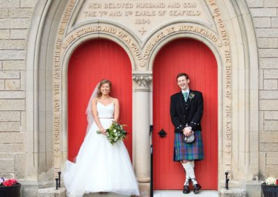 a couple photographed outside of grantown church by inverness wedding photographer roddy mackay