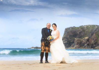 a photograph of a bridal couple on a beach on the isle of lewis