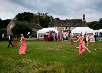 bridesmaids play badminto at a heathy lea weddings
