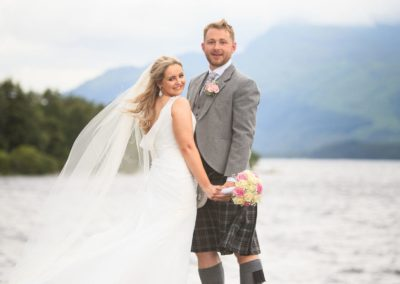 a couple photographed at luss pier by loch lomond