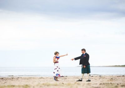 a couple dance together on their wedding day on nairn beach