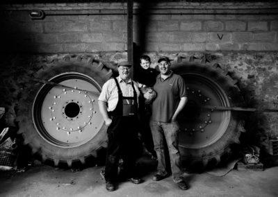 Grandad, son and grandson farmers photographed on the farm