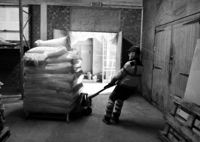 A workman works with a delivery of Malt in Bairds manufacturing plant in grantham