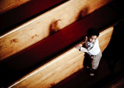 a young boy is photographed in a church in glasgow