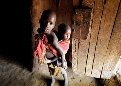 boys-in-the-doorway-of-a-home-in-uganda