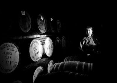 allan logan of bruichladdich distillery photographed in a warehouse on islay