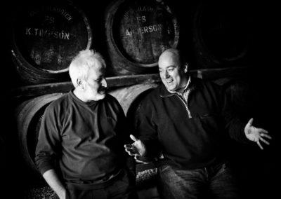simon coughlin and duncan macgillivray share a joke in a warehouse at bruichladdich distillery
