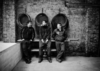 warehousemen pose for the camera at bruichladdich distillery on islay