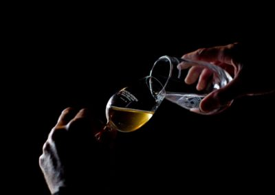 whisky is poured into a bruichladdich glass at the distillery on islay