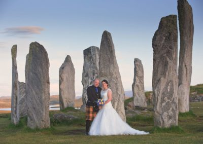 a wedding couple photographed at the callanish stones on the isle of lewis