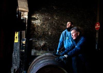 warehouse men moves barrels at bruichladdich distillery in a photo by inverness commercial photographer, roddy mackay