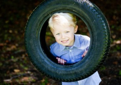 a boy looks at the camera in his family portrait session