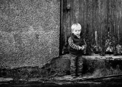 a black and white photograph of a boy by inverness family photographer roddy mackay