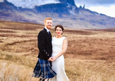 a bride and groom photographed at the old man of storr on the isle of skye