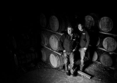 jim mcewand and allan logan in a whisky warehouse of bruichladdich distillery