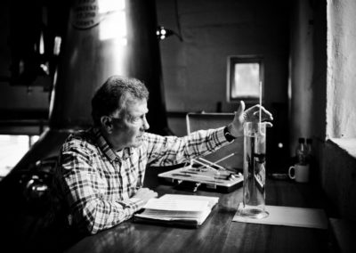 jim mcewan studying the spirit at bruichladdich distillery