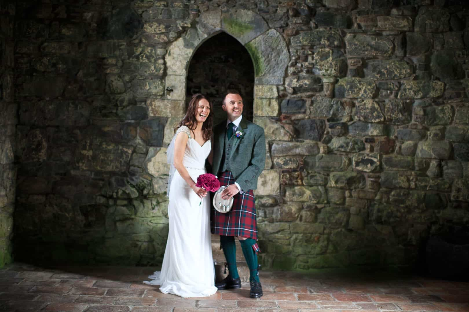 a bride and groom photographed on their wedding in rodel church in harris