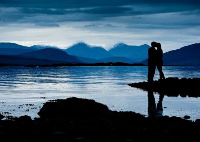 a couple kiss on the isle of skye during their elopement wedding